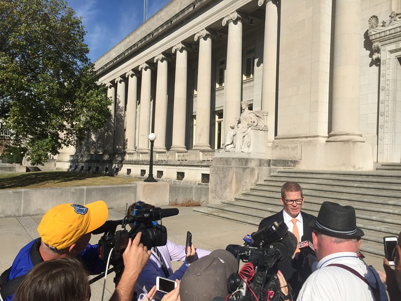 Just City executive director Josh Spickler speaks during a news conference on the steps of the Shelby County Courthouse. - TOBY SELLS