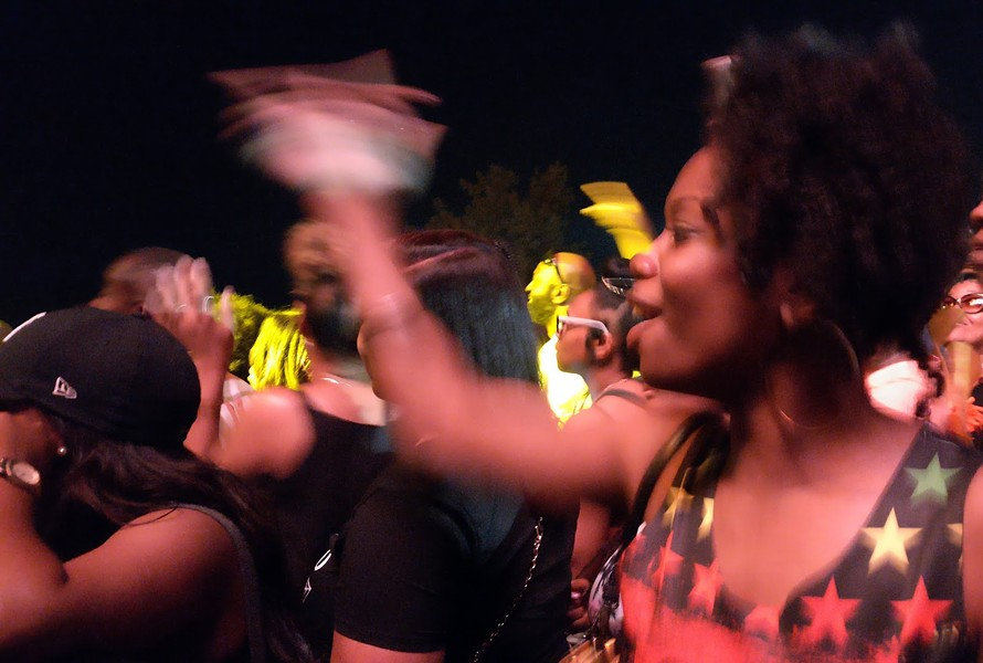 In the crowd at the River Stage, Nashun Wright sings along to Jill Scott. - E.J. FRIEDMAN