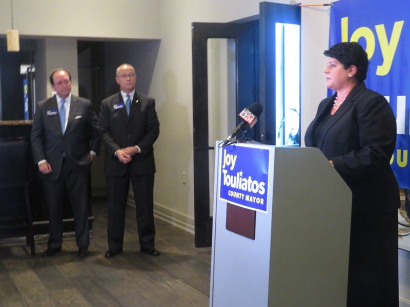 Joy Touliatos announces for County Mayor as prominent backers John Bobango and Brent Taylor look on. - JB