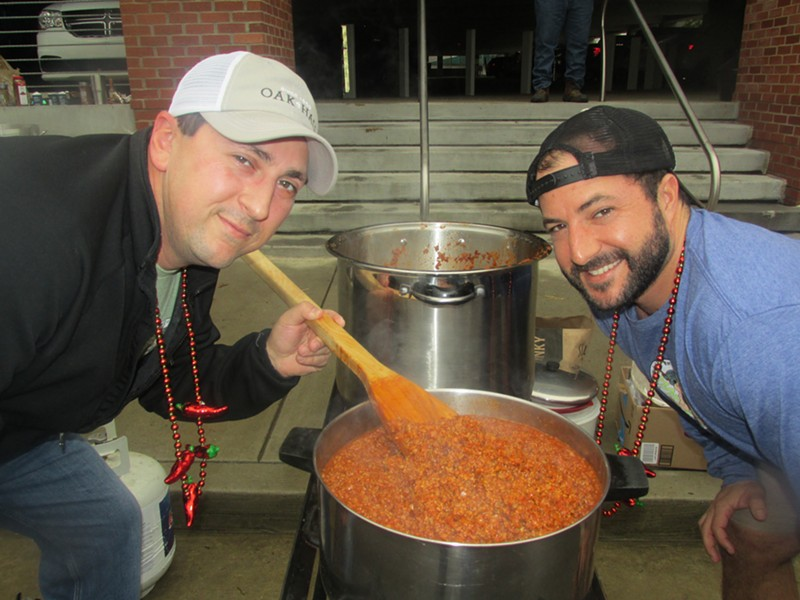 Tasting the goods at the Exceptional Foundation of West Tennessee Chili Cook-Off - MICHAEL DONAHUE