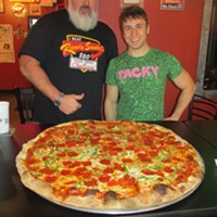 "Michael ""Big Eater Mike"" Whities and Brett ""The Brranimal"" Healey at the pizza challenge at Rizzi's Pizza,"