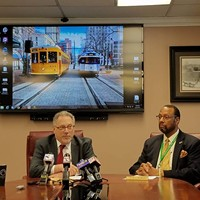 MATA CEO Gary Rosenfeld (left) and COO Alvin Pearson announce the return of the trolleys during a news conference.