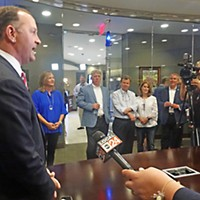 Republican mayoral nominee David Lenoir faces the press at Evolve Bank on Poplar