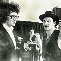 Michael Donahue interviews Bono in 1987 at Sun Studios.  That's Donahue on the left.