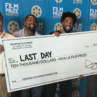 """Kevin Brooks (third from left) accepts the Memphis Film Prize he won for his short """"Last Day"""". From the left is Film Prize Filmmaker's liaison David Merrill, """"Last Day"""" star Ricky D. Smith, Brooks, and Louisiana Film Prize founder Gregory Kallenberg."""