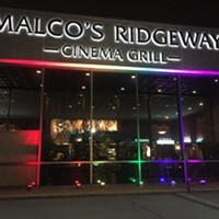 Malco Ridgeway Cinema Grill lit up with the LBGTQ rainbow for the Outflix Film Festival.