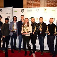 Winning filmmakers on the red carpet at the 2019 Oxford Film Festival, (left to right) John Charter, Paul Kaiser, Timothy Blackwood, Bradford Downs, Suzannah Herbert, Morgan Jon Fox, John Rash, Will Stewart, and Christian Walker