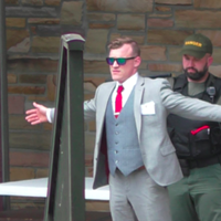 White nationalist Peter Teftt is searched by Tennessee State Park Rangers before the American Renaissance conference at Montgomery Bell State Park in May, according to Unicorn Riot.
