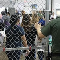 Children line up inside a U.S. immigration detention center.