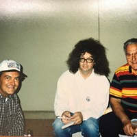 This photo may be at the first Zoo Rendezvous. That's Nick Vergos (at left) and his dad, the late Charlie Vergos, who founded the Rendezvous. That is my real hair.