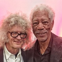 A non-Academy Award winner  wearing glasses with an Academy Award winner at the Moonshine Ball. Morgan Freeman was a guest at the event, held November 22nd.
