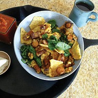 Breakfast nachos with egg, carrots, and spinach