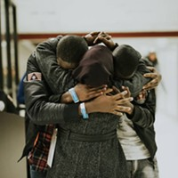 Refugee family reunites at airport