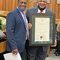 Graduation Day:  County Clerk Ed Stanton Jr. (right) was honored by the Shelby County Commission Monday as he entered retirement after a county government career that began in 1972. Commissioner Eddie Jones, enjoying a milestone of his own on his first day as chairman of the county commission, did the honors.