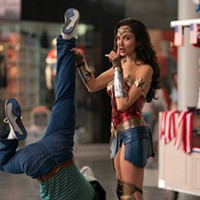 Gal Gadot takes out the garbage in Wonder Woman 1984.