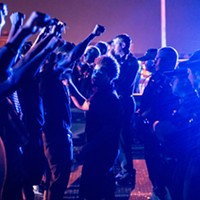 Protesters and police officers face off during the 2016 Hernando de Soto Bridge protest