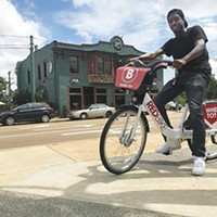 Marcellus Benton, B-Cycle assistant, rides a bicycle at Overton Square's Bike Share demo.