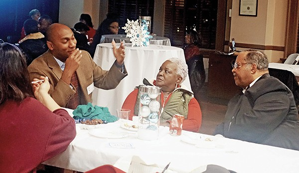 Candidates in next year's elections are making the rounds of holiday gatherings. Here Lee Harris, candidate for County Mayor, pitches Mary and Myron Lowery at the annual party of the Shelby County Democratic women. - JACKSON BAKER