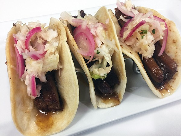 Slow roasted brisket taco with sweet pickle slaw