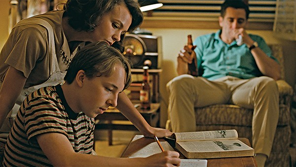 Carey Mulligan, Ed Oxenbould, and Jake Gyllenhaal (left to right) star in Paul Dano's tightly composed new drama,Wildlife.
