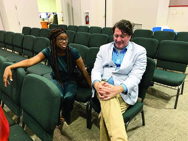 Harris supporter Danielle Inez and nay-voter David Upton muse over the outcome. - JACKSON BAKER
