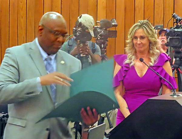 """Criminal Court Clerk Heidi Kuhn (right) was recently presented with a """"Good Samaritan"""" Award from the County Commission for her heroic life-saving efforts at the scene of a traffic accident. Commissioner Reginald Milton does the honors. - JACKSON BAKER"""