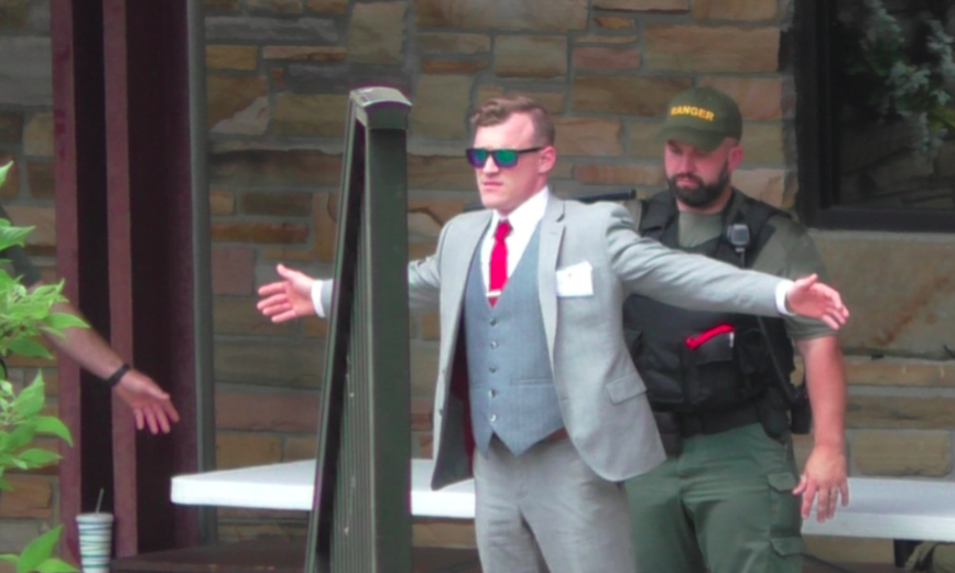 White nationalist Peter Teftt is searched by Tennessee State Park Rangers before the American Renaissance conference at Montgomery Bell State Park in May, according to Unicorn Riot. - UNICORN RIOT