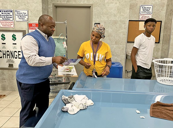 Councilman Sherman Greer campaigning in district coin-op laundry