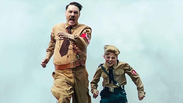 Taika Waititi (left) and Roman Griffin Davis skewer fascism in Waititi's Jojo Rabbit.