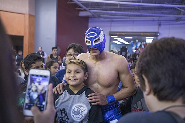 Blue Angel poses with a fan at a recent MLLW event.