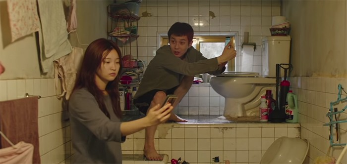 Searching for free wi-fi in the Kim family bathroom.
