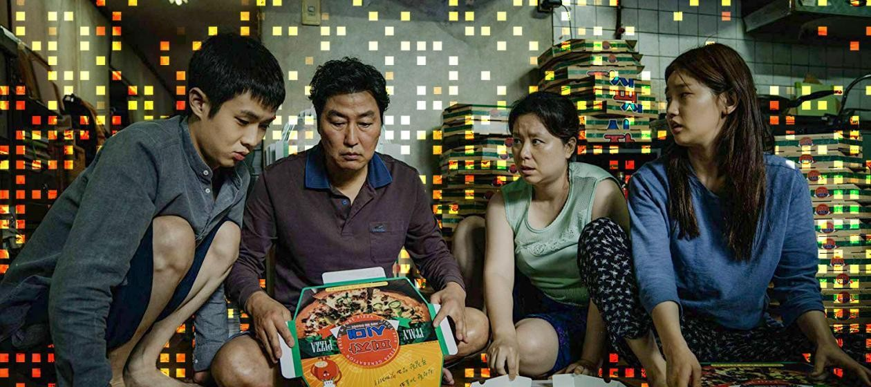 Choi Woo-shik, Song Kang-ho, Jang Hye-jin, and Park So-dam as a family of grifters in Parasite.