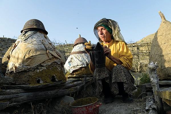 Hatidze Muratova tends her hives in Honeyland.