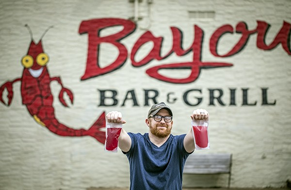 Drinking local with hurricanes in pouches from Bayou Bar & Grill. - JUSTIN FOX BURKS