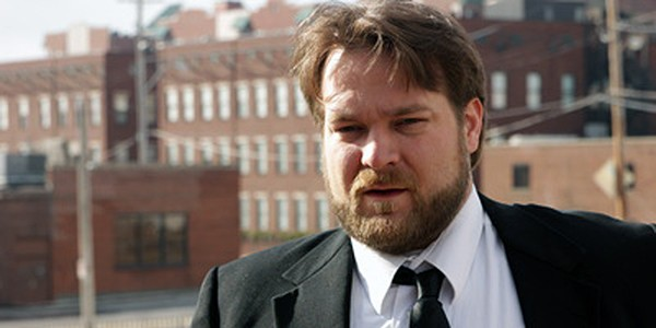 Eric Tate stars as a desperate director in Lights, Camera, Bullshit