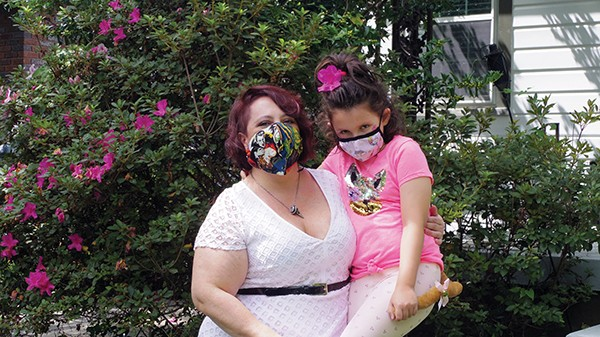 University of Memphis professor Marina Levina and daughter Sasha aren't afraid of these monster and mythical creature masks. - JESSE DAVIS