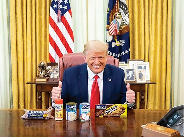 President Donald Trump poses with a can of beans and other Goya products.