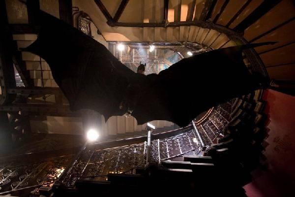 Christian Bale as Batman drops in.