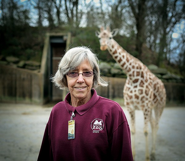 Carolyn Horton and Kofi the giraffe - JAMIE HARMON