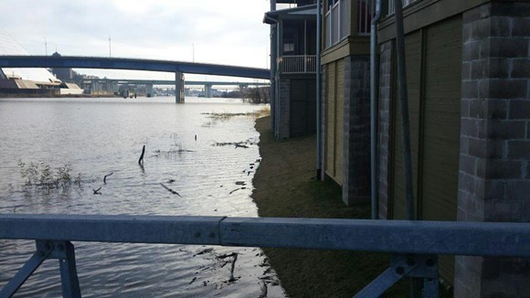 Flood waters creep up on homes along the Wolf River Harbor in 2015.
