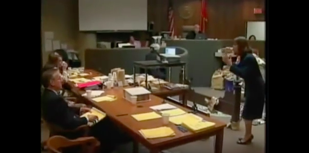 "Weirich (right, standing) implores Noura Jackson (far left, seated) ""Just tell us where you were!"" during her closing argument. - YOUTUBE"