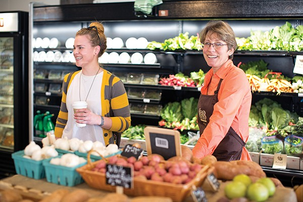 Pamela Rains welcomes Midtowners to Curb Market — the new grocery store.