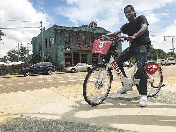 Marcellus Benton, B-Cycle assistant, rides a bicycle at Overton Square's Bike Share demo. - JOSHUA CANNON
