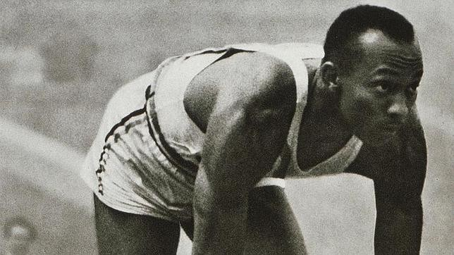 Jesse Owens prepares to set a world record at the Berlin Olympics.