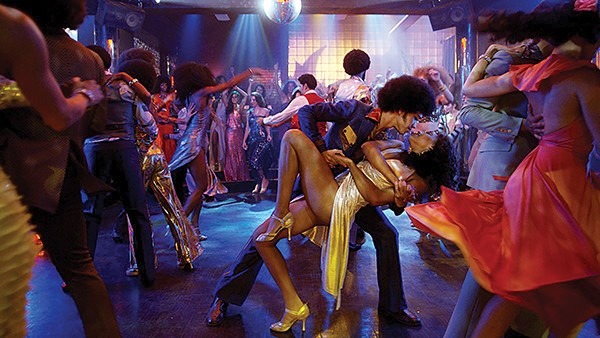 Justice Smith (left) dips Herizen F. Guardiola in The Get Down.