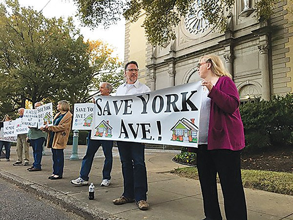 Neighbors protested the Church of the Immaculate Conception. - JOSHUA CANNON