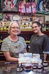 Sue Jordan (left) and Bella Golightly with CBD gummies, oils, and other products at Maggie's Pharm in Midtown.