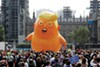 Protesters fly the baby blimp in the U.K.
