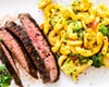 Flank steak with broccoli mac and cheese