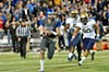 Paxton Lynch is chased from the pocket.